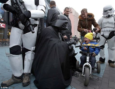 Boy in tears meeting Darth Vader on campaign trail for